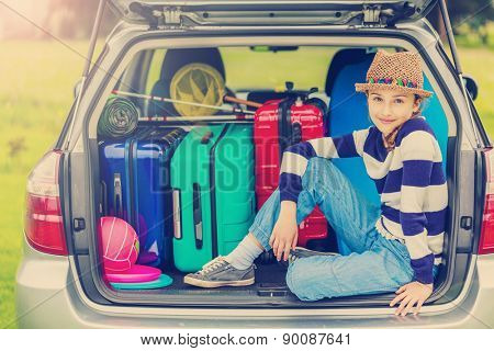 Summer vacation, young girl ready for travel for family vacation-filtered