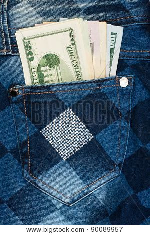 Money Sticks Out Of The Pocket Of His Jeans With Rhinestones
