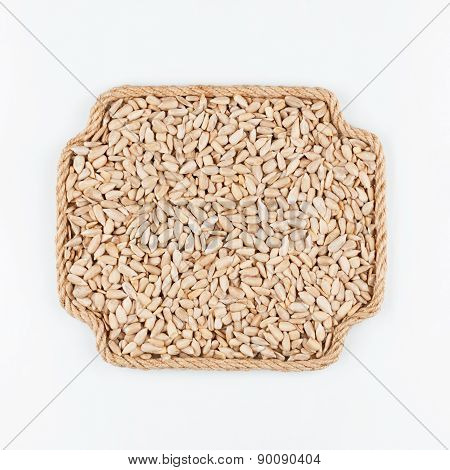 Frame Made Of Rope With  Sunflower  Seeds  Lying On A White Background