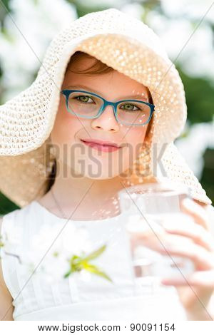 Summer Little Girl In Straw Hat Drinking Water Outdoor Portrait.