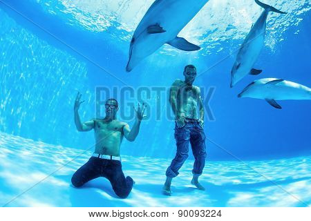 two men and three dolphin