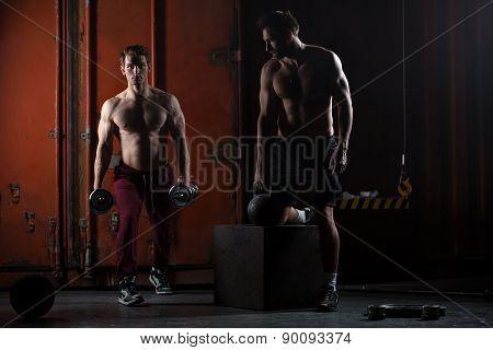 Two beautiful athlete train