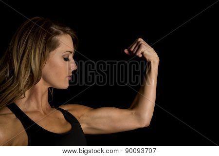 Fit Woman In Black Tank Top Flex Look Side