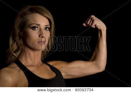 Fit Woman In Black Tank Top Flex Looking