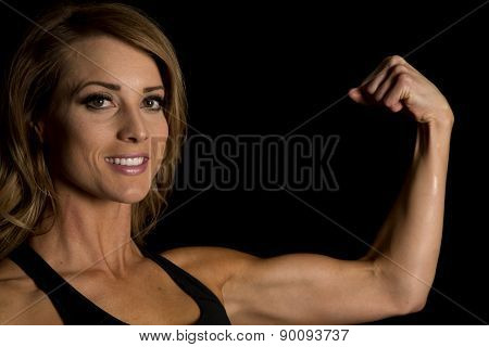 Fit Woman In Black Tank Top Flex Look Smiling