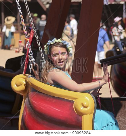 A Girl On A Ride At The Arizona Renaissance Festival