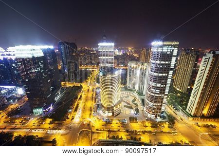 busy traffic and modern city skyline at night