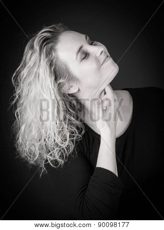 portrait of attractive woman on black background