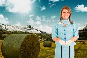 stock photo of air hostess  - Air hostess against scenic backdrop - JPG