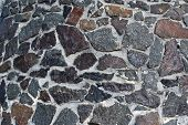 foto of fortified wall  - Wall built of granite stone on cement - JPG