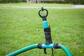 stock photo of sprinkler  - Old and DIY sprinkler on the grass - JPG