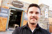 foto of barber  - Portrait Of Hipster Barber Standing Outside Shop - JPG