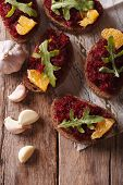 picture of canapes  - Canape with beets oranges and rucola close - JPG