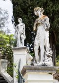stock photo of palace  - Classical inspired statues on the grounds of the Achillion Palace on the island of Corfu - JPG