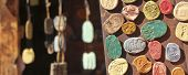 foto of chimes  - A Display of Rustic Clay Refrigerator Magnets and Wind Chimes - JPG