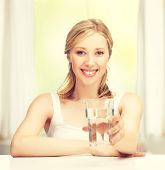 stock photo of glass water  - closeup of young smiling woman with glass of water - JPG
