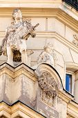 pic of stone sculpture  - stone facade on classical building with ornaments and sculptures - JPG