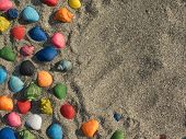 stock photo of beach shell art  - a lot of shells in the sand - JPG