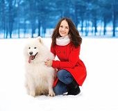 stock photo of christmas dog  - Winter christmas and people concept  - JPG
