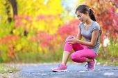 picture of knee  - Sports running knee injury on woman in pain - JPG
