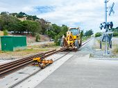 stock photo of railroad yard  - Multiple rails wait for installation on a train track - JPG