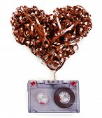 stock photo of magnetic tape  - Audio cassette with magnetic tape in shape of heart isolated on white - JPG