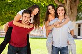 image of piggyback ride  - Group of college friends having fun - JPG
