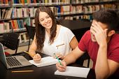 pic of mans-best-friend  - Cute brunette flirting and laughing with a friend she likes while studying in the library  - JPG