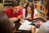 image of time study  - Group of young adults studying together and having a good time in the school library - JPG
