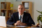 foto of psychologist  - Portrait of senior psychologist at his workplace - JPG