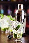 picture of mojito  - Mojito cocktail shot on a bar counter in a nightclub - JPG