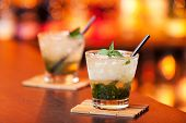 stock photo of mints  - Mint Julep cocktail shot on a bar counter in a nightclub - JPG