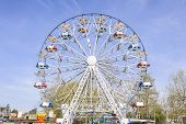 stock photo of ferris-wheel  - Ferris Wheel at the county fair with the sky in the background - JPG