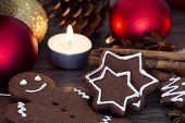 foto of gingerbread man  - Gingerbread man cookies star anise cinnamon and cookbook - JPG