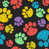 stock photo of paw-print  - Cute seamless pattern with colorful hand drawn doodle paw prints - JPG