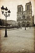 stock photo of notre dame  - The Cathedral of Notre Dame de Paris in vintage style France - JPG