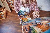 foto of finger-painting  - Male artist painting Venetian street - JPG
