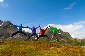 picture of lofoten  - Sporty friends jumping and enjoy holiday break in Norway mountains - JPG