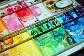 foto of messy  - A picture of a very colorful and messy palette - JPG