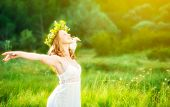 pic of open arms  - happy woman in wreath outdoors summer enjoying life opening hands - JPG