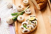 picture of green onion  - sandwich with fresh mushrooms mayonnaise and green onion on the board - JPG