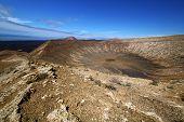 stock photo of volcanic  - vulcanic timanfaya rock stone sky hill and summer in los volcanes lanzarote spain - JPG