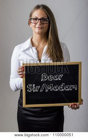 Dear Sir/madam - Young Businesswoman Holding Chalkboard With Text