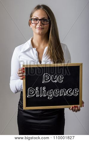 Due Diligence - Young Businesswoman Holding Chalkboard With Text