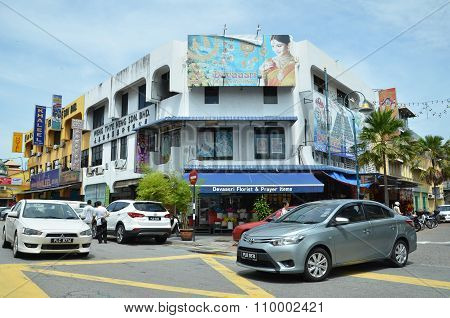 A Street Scape View Of Buildings, Traffic And Daily Life In Georgetown, Malaysia