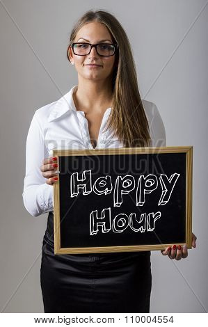 Happy Hour - Young Businesswoman Holding Chalkboard With Text