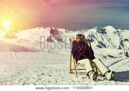 Woman at mountains in Santa hat celebrating christmas, Meribel, Alps, France