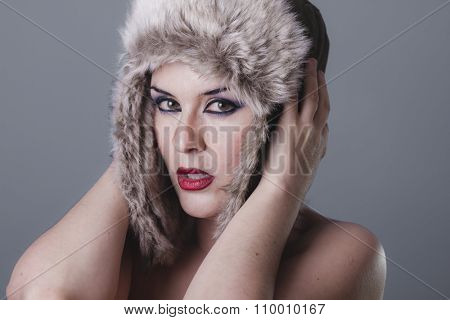 one naked girl with Russian winter hat, cold