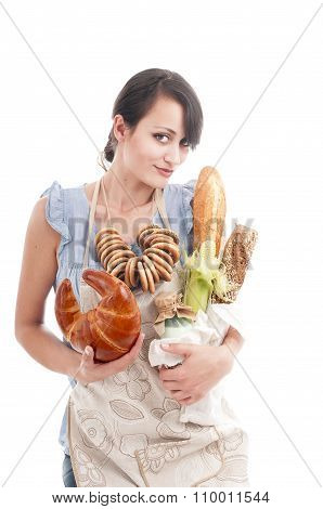 Young Beautiful Woman Holding Bags With Fresh  Bread And Other Foodstuffs