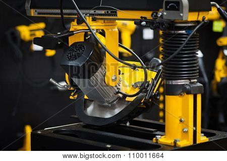 Industrial Circular Saw. Black Workshop Background